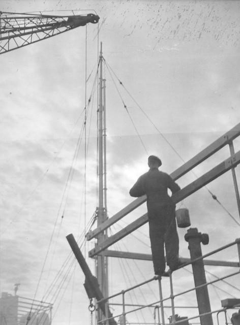 This image has been taken from the Joseph L Thompson & Sons Ltd shipbuilders' collection. A painter working on a super structure at J L Thompson & Sons